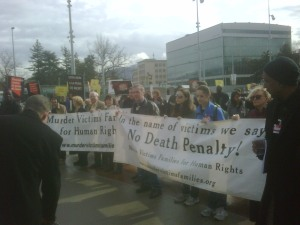 Murder Victims Families for Human Rights parade with banner